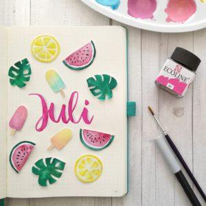 Brushlettering Juli mit Wasserfarben Melonen. Eis. Monstera und Zitrone von Zauber ein Lächeln.