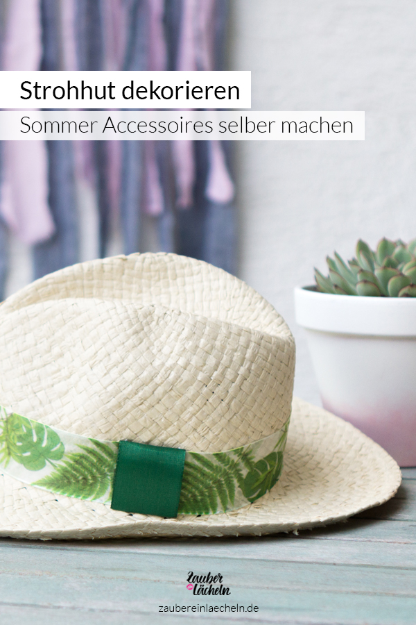 Einfache DIY-Idee mit Anleitung für Sommer Accessoires zum selber machen. Strohhut im Jungle Vibes Look neu dekorieren. Schöne DIY-Idee passend zu deinem Sommer Outfit. Schritt für Schritt erklärt, wie das Band ausgetauscht wird, jetzt schnell entdecken.